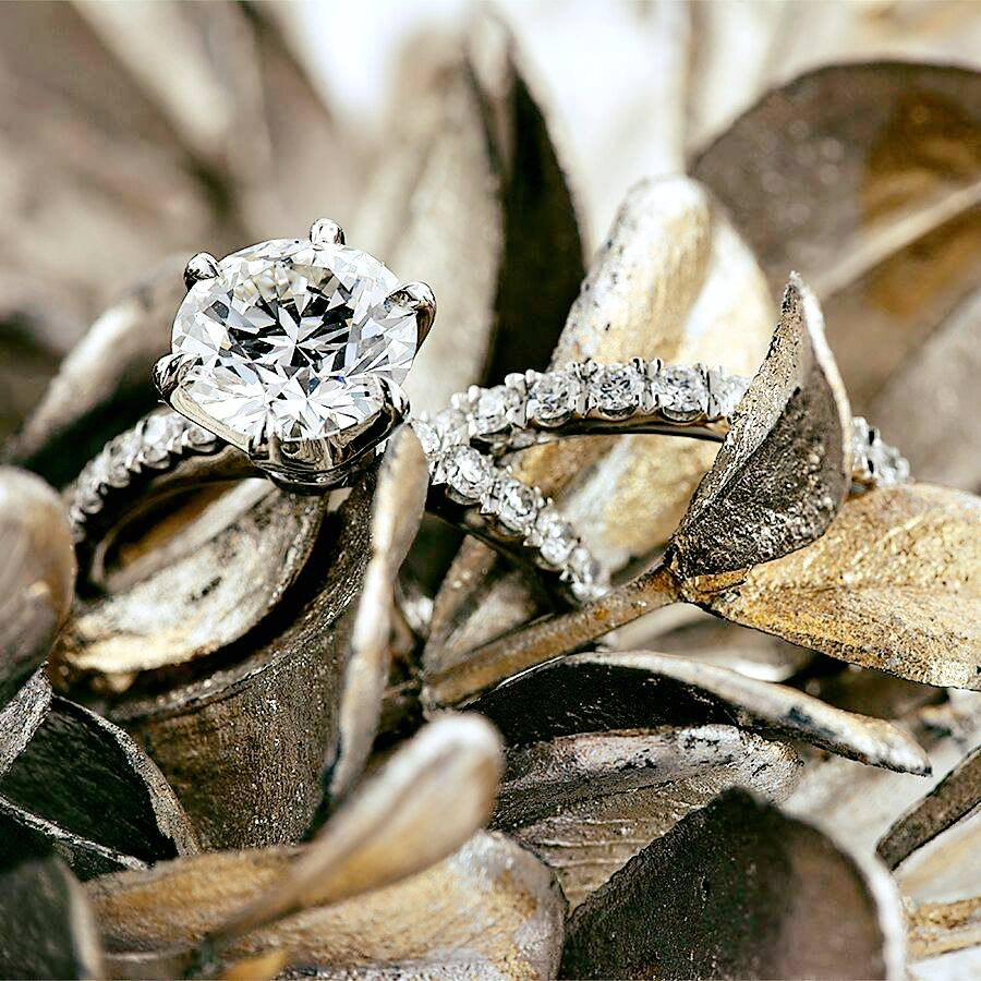 Hpdiamonds take polishing to the next level in the 6 prong, pave style engagement ring set.