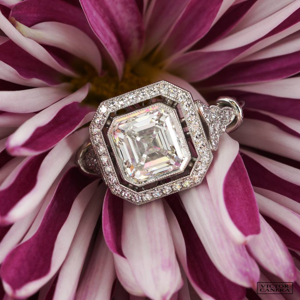 Victor Canera's photography matches the quality offered in his handmade settings. This beautiful Asscher cut diamond is showcased perfectly in a double halo style with a art deco, vintage feel.