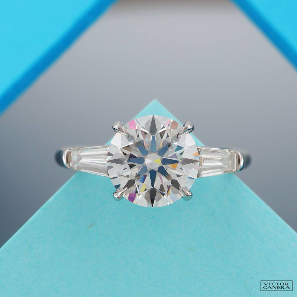 Your classic round with baguette sides. Victor Canera sure knows how to properly present the perfection of diamonds.