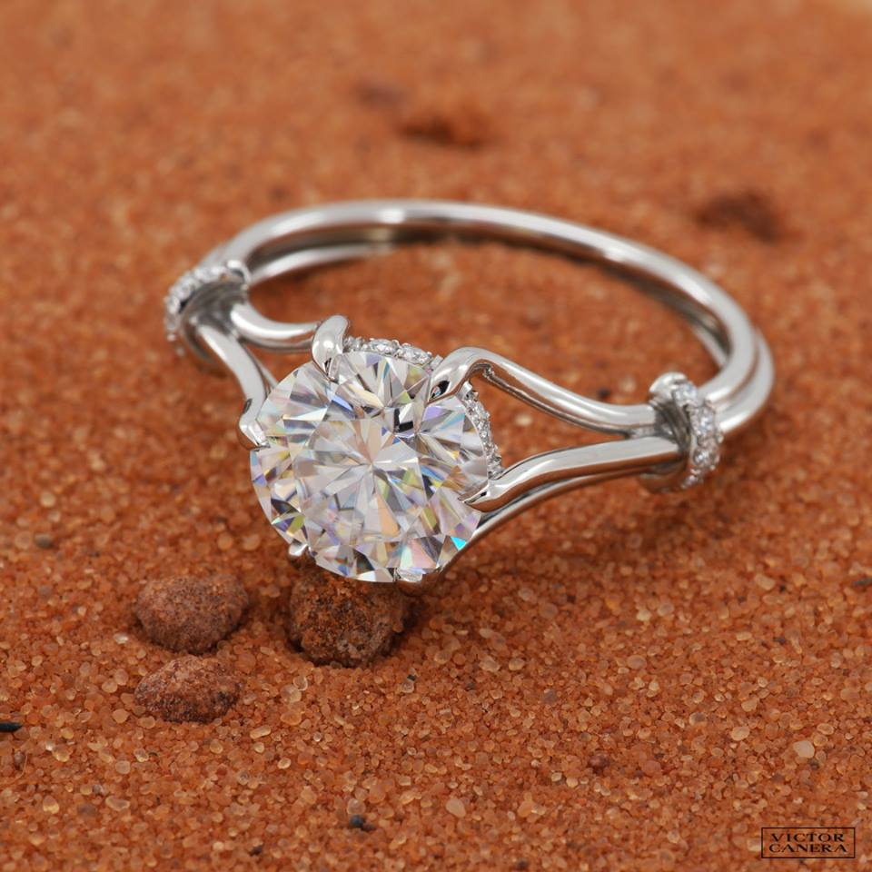 Victor Canera with a white gold,  4 prong, wire style shank presenting a Canera ideal hearts diamond.